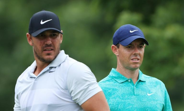 No love lost: Four-time major winners Brooks Koepka (left) and Rory McIlroy