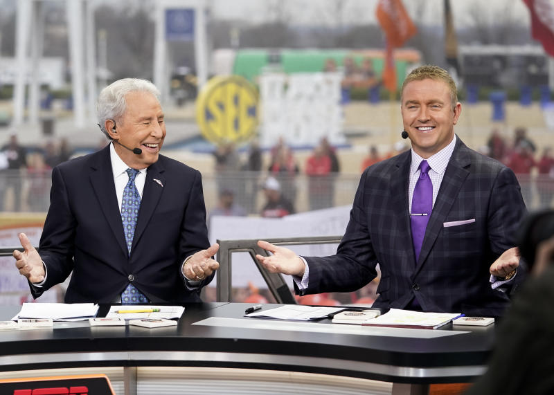 """Lee Corso and Kirk Herbstreit at ESPN's """"College GameDay"""" during a game between the Georgia Bulldogs and LSU Tigers at Mercedes Benz Stadium on Dec.7, 2019 in Atlanta, Georgia. (Steve Limentani/ISI Photos/Getty Images)"""