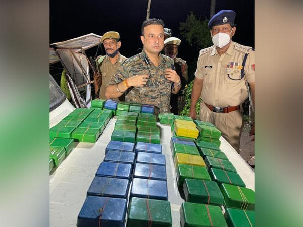 Assam Police with seized consignment of drugs. (Photo/ANI)