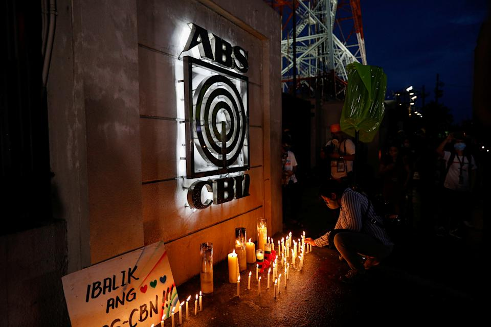 FILE PHOTO: A journalist lights a candle outside the ABS-CBN headquarters, following Philippine congress' vote against the broadcast network's franchise renewal, in Quezon City, Metro Manila, Philippines, July 10, 2020. (Source: REUTERS/Eloisa Lopez)
