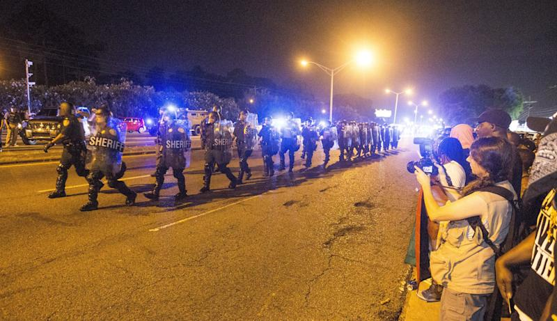 BATON ROUGE, LA -JULY 09: Law enforcement leave the protesters after moving in and making arrest on July 9, 2016 in Baton Rouge, Louisiana. Alton Sterling was shot by a police officer in front of the Triple S Food Mart in Baton Rouge on July 5th, leading the Department of Justice to open a civil rights investigation. (Photo by Mark Wallheiser/Getty Images)