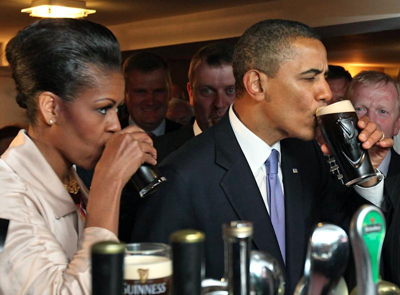 President Barack Obama And First Lady Michelle Obama Enjoy A Pint Of Guinness At Hayes Bar In His Ancestral Home Moneygall, Co Offaly During President Obama'S Visit To Ireland. (Photo by Mark Cuthbert/UK Press via Getty Images)