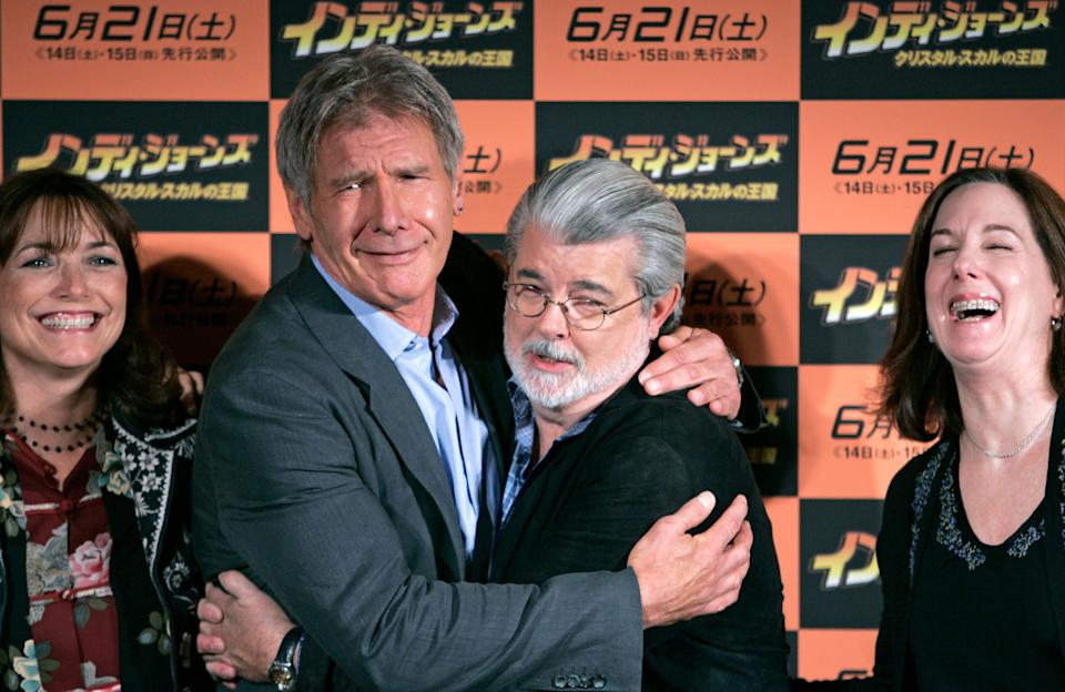 """Actor Harrison Ford (2nd L) and executive producer George Lucas (2nd R) pose with actor Karen Allen (L) and producer Kathleen Kennedy (R) during a photocall for """"Indiana Jones and the Kingdom of the Crystal Skull"""" in Tokyo June 4, 2008. REUTERS/Michael Caronna (JAPAN)"""