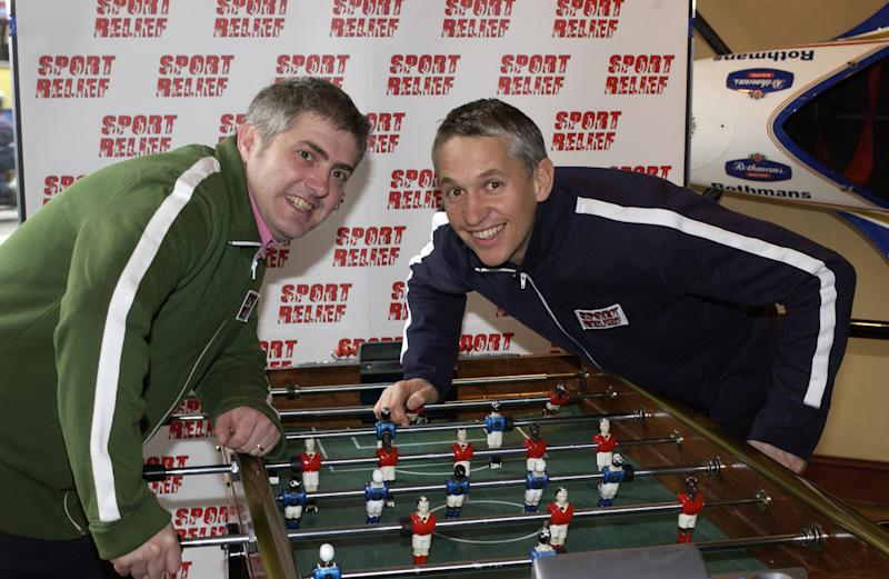 LONDON - MAR 5: Gary Lineker (right) and Nick Hancock (left) smiling in front of a sport relief banner for the launch of sport relief 2002 in London, England. (Photo by Comic Relief/Getty Images)