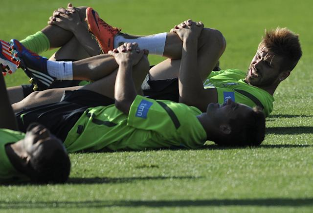Portugal's national football team midfielder Miguel Veloso (R) chats with teammates as they stretch on May 28, 2012 during training in Obidos, central Portugal, in preparation for the Euro 2012 football championship, which will take place in Poland and Ukraine from June 8 to July 1. AFP PHOTO/ FRANCISCO LEONGFRANCISCO LEONG/AFP/GettyImages