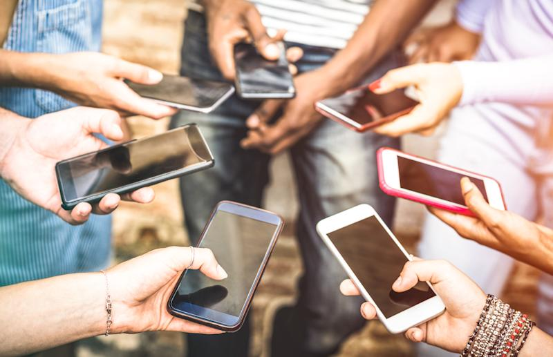 Today's teens spend much less time with peers or family in person, and much more time connecting to others electronically through social media. (Photo: Getty Creative)