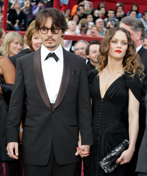 """FILE - This Feb. 24, 2009 file photo shows Johnny Depp, nominated for an Oscar for best actor in a leading role for his work in """"Sweeney Todd The Demon Barber of Fleet Street,"""" arriving with his girlfriend Vanessa Paradis for the 80th Academy Awards in Los Angeles. Depp and his longtime partner, Vanessa Paradis, have split. A publicist for Depp said in a statement Tuesday, June that the couple """"amicably separated."""" The statement requested privacy for the former couple and their two children, 9-year-old Jack and 13-year-old Lily-Rose. Depp and Paradis never married during their 14-year relationship. The American actor met the French model-singer in 1998. (AP Photo/Amy Sancetta, file)"""