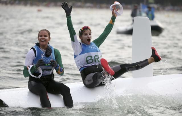 2016 Rio Olympics - Sailing - Final - Women's Skiff - 49er FX - Medal Race - Marina de Gloria - Rio de Janeiro, Brazil - 18/08/2016. Martine Grael (BRA) of Brazil and Kahena Kunze (BRA) of Brazil celebrate gold medal. REUTERS/Benoit Tessier TPX IMAGES OF THE DAY FOR EDITORIAL USE ONLY. NOT FOR SALE FOR MARKETING OR ADVERTISING CAMPAIGNS.