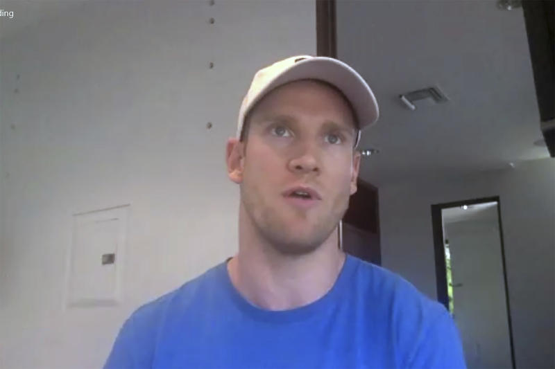 In this photo taken from video, Tennessee Titans NFL football quarterback Ryan Tannehill speaks to reporters about staying in shape during the offseason from his home in Florida, Tuesday, April 28, 2020. (Teresa Walker/Zoom via AP)
