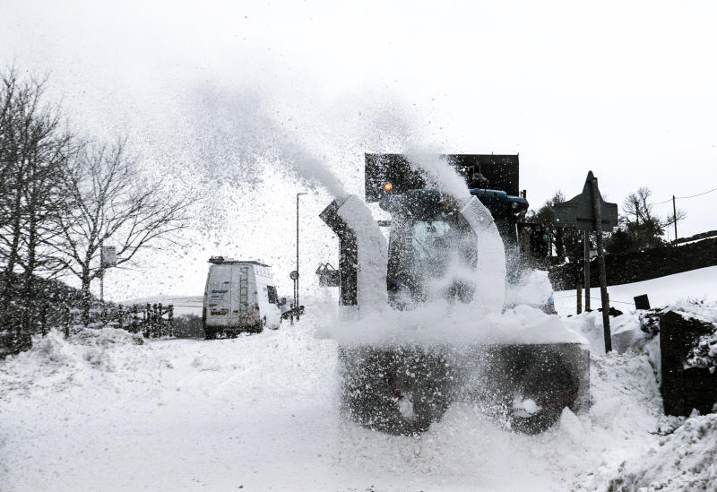 """Snow is cleared from a road in Hayfield in Derbyshire as the wintry snap dubbed the """"mini beast from the east"""" keeps its grip on the UK."""