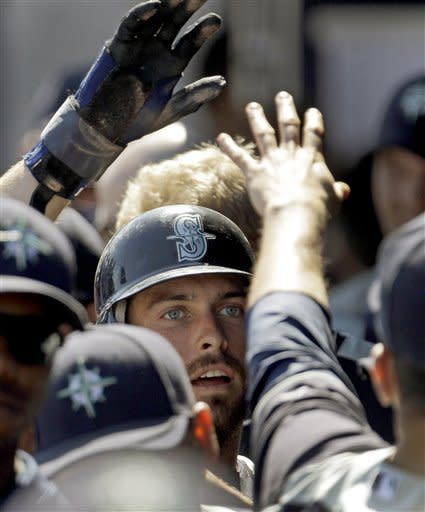Ackley looks sharp as Mariners beat Padres 13-7