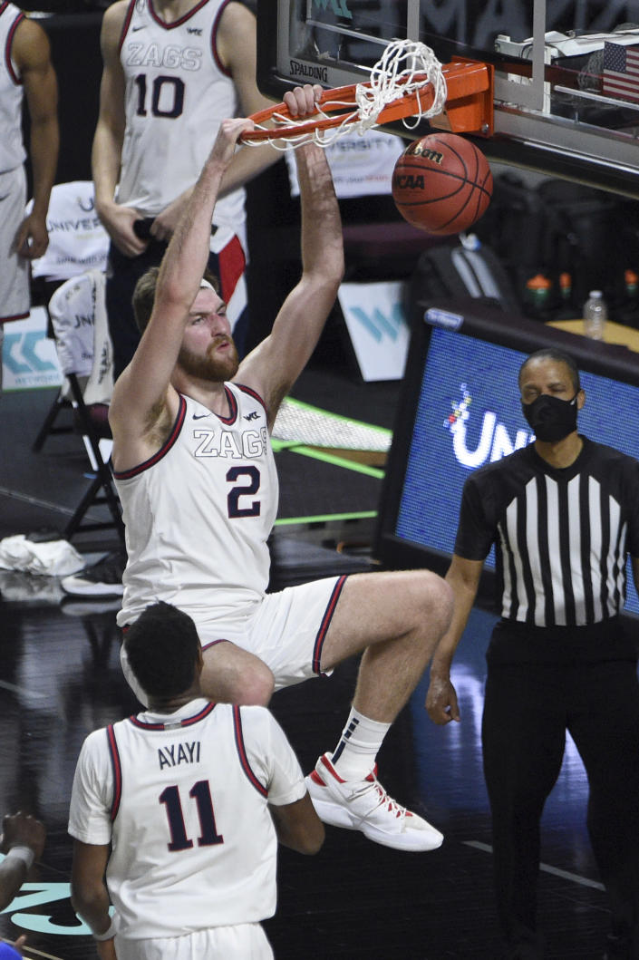 Gonzaga forward Drew Timme (2) dunks against Gonzaga during the second half in an NCAA college basketball game for the West Coast Conference men's tournament championship Tuesday, March 9, 2021, in Las Vegas. (AP Photo/David Becker)