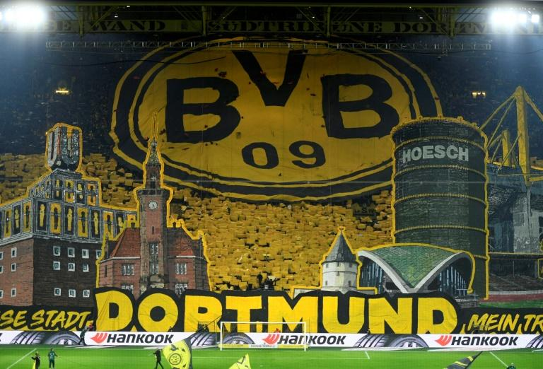 Dortmund supporters in the famed 'Yellow Wall' display a giant tifo