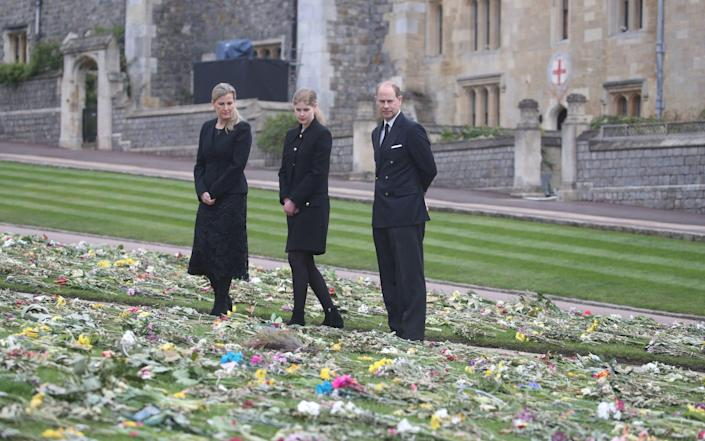 Edward, Sophie and Louise view flowers outside St George's Chapel, Windsor, following the death of Prince Philip - AFP