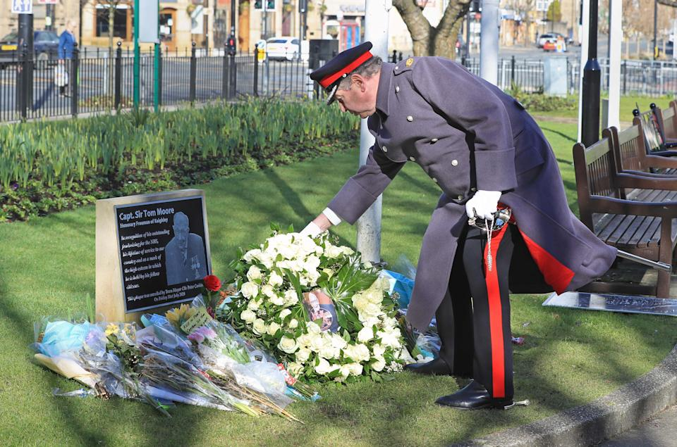 David Pearson, Deputy Lieutenant for West Yorkshire lays a wreath of 200 white roses at the Sir Tom Moore memorial plaque in Keighley, West Yorkshire, on the day of Captain Sir Tom Moore's funeral. Picture date: Saturday February 27, 2021. (Photo by Danny Lawson/PA Images via Getty Images)
