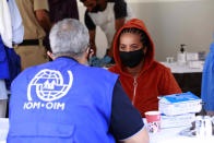 A vaccination campaign against the coronavirus is underway at a Tripoli shelter for migrants, organized jointly by the Libyan center for disease control and the International Organization for Migration. in Tripoli, Libya, Wednesday Oct. 6, 2021. (AP Photo/Yousef Murad)