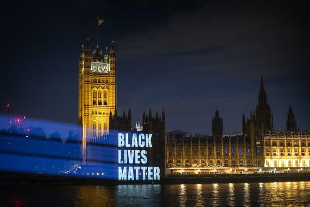Black Lives Matter is projected onto the Houses of Parliament