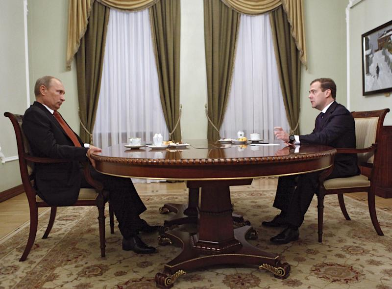 Russian President Vladimir Putin, left, and Russian Prime Minister Dmitry Medvedev meet in the Novo-Ogaryovo residence outside Moscow, Thursday, Sept. 27, 2012. A year ago, Dmitry Medvedev showed an unswerving loyalty to his mentor Vladimir Putin when he refused to seek a second presidential term and agreed to swap jobs. But Medvedev's self-denial hasn't prevented Putin from systematically rolling back indecisive and half-hearted attempts at liberal reforms made by his pliant placeholder during four years in the Kremlin. That campaign has seen the revision of Medvedev's laws, the reversal of some of his key policies and even rolling back his initiative to move the clock.   (AP Photo/RIA-Novosti, Dmitry Astakhov, Government Press Service)