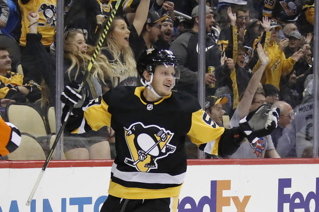 """FILE - In this Oct. 16, 2019, file photo, Pittsburgh Penguins' Jake Guentzel celebrates after scoring during the second period of an NHL hockey game against the Colorado Avalanche in Pittsburgh. Guentzel feared his season was over thanks to a shoulder injury in December. The """"pause"""" caused by the pandemic has given him renewed optimism that he will be ready when the playoffs hopefully being this summer. (AP Photo/Gene J. Puskar, File)"""