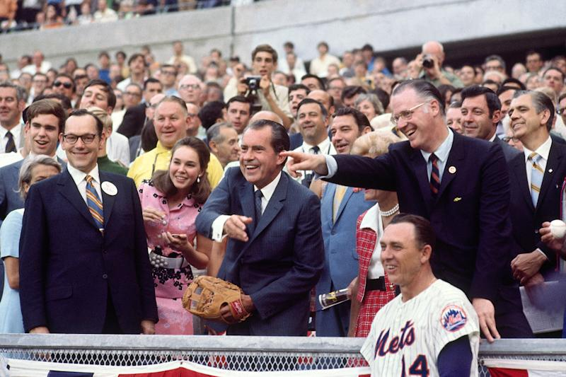 Nixon throws out the first pitch in Cincinnati at the 1970 All-Star Game in Cincinnati as commissioner Bowie Kuhn and Mets manager Gil Hodges observe. (Photo by Herb Scharfman/Sports Imagery/Getty Images)