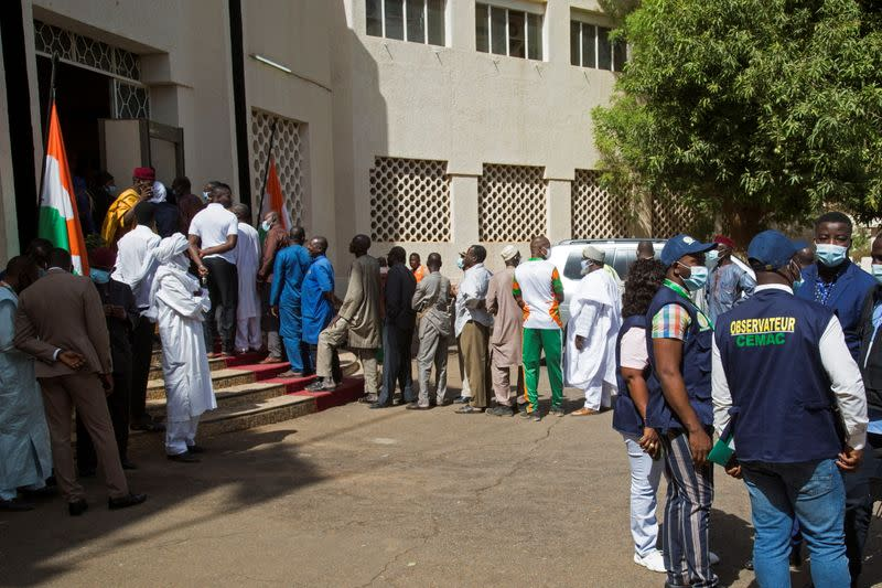 Voters queue at a polling station during the second round of the country's presidential election, in Niamey