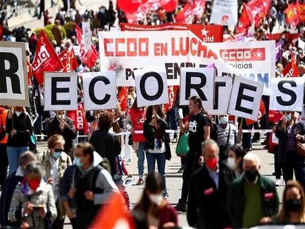 People hold placards during a protest to mark the International Labour Day in Madrid, Spain, May 1, 2021. (Photo Credit: REUTERS)