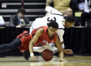 VMI forward Myles Lewis (15) scrambles to recover a loose ball against Wofford guard Donovan Theme-Love (31) in the first half of an NCAA college basketball game for the Southern Conference basketball tournament championship, Saturday, March 9, 2018, in Asheville, N.C. Wofford won 99-72. (AP Photo/Kathy Kmonicek)