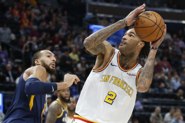 Golden State Warriors center Willie Cauley-Stein (2) goes to the basket as Utah Jazz center Rudy Gobert, left, defends in the first half during an NBA basketball game Friday, Dec. 13, 2019, in Salt Lake City. (AP Photo/Rick Bowmer)