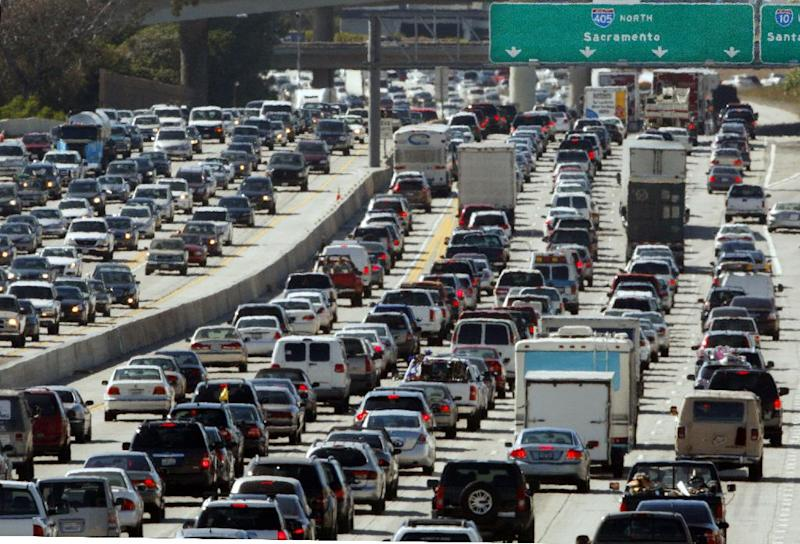 FILE - In this May 28, 2010 file photo, the rush hour commute starts in early afternoon and with greater intensity as traffic is jammed in both directions on Interstate 405 on the Westside of Los Angeles as commuters and Memorial Day vacationers hit the road. It's going to be another busy Memorial Day weekend on the nation's highways. During Thursday, May 23, 2013 and Monday, May 27, 2013, 31.2 million Americans will drive 50 miles or more to a beach, campground or other getaway, according to car lobbying group AAA. (AP Photo/Reed Saxon, File)
