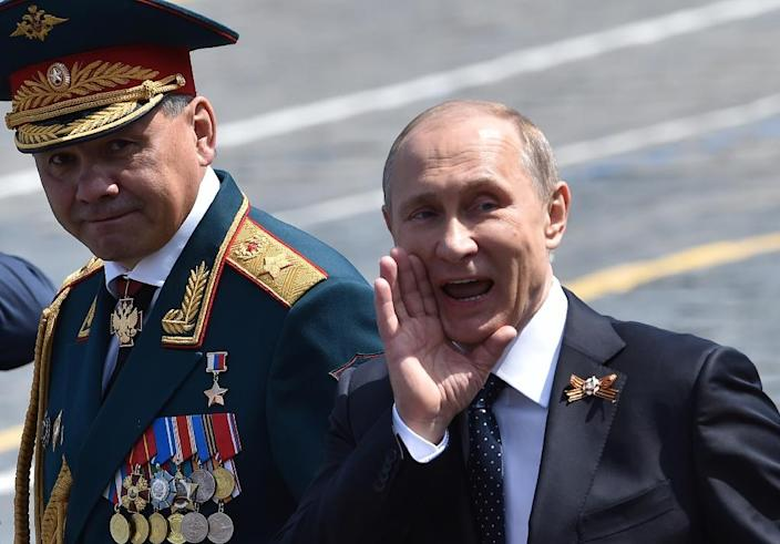 Russian President Vladimir Putin (R) and Defence Minister Sergei Shoigu leave Moscow's Red Square after the Victory Day military parade on May 9, 2015 (AFP Photo/Kirill Kudryavstev)