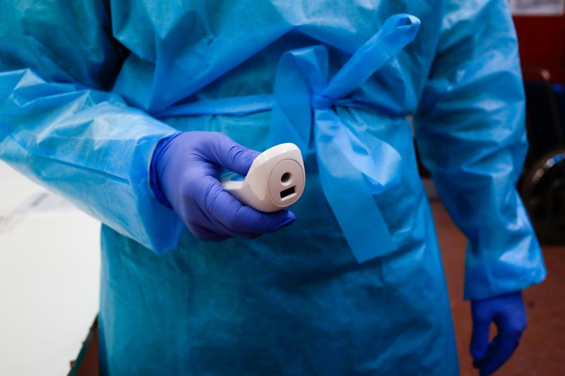 Health personnel work in the triage area at the Molinette hospital as they try to prevent further coronavirus cases on February 26, 2020 in Turin, Italy. After the first suspected cases of positivity to CoronaVirus, prevention measures have also started in Piedmont. Healthcare staff operating in the screening of Coronavirus at the Molinette hospital in Turin operate to separate usual patients from potentially infected by Covid-19. (Photo by Mauro Ujetto/NurPhoto via Getty Images)