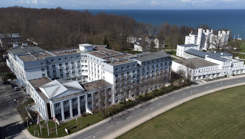 Exterior view of the 'MEDIAN Clinic Heiligendamm' (front left) in Heiligendamm, northern Germany, Wednesday, April 14, 2021. The MEDIAN Clinic, specialized on lung diseases, treats COVID-19 long time patients from all over Germany. (AP Photo/Michael Sohn)