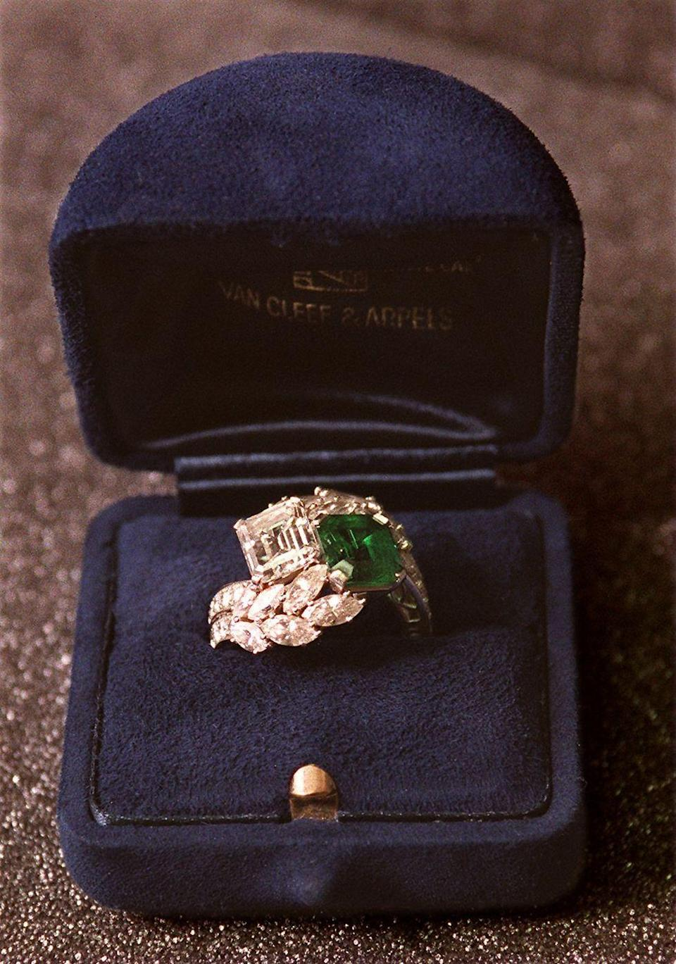 <p>The public took an interest in Jacqueline Kennedy long before she was the First Lady of the United States. In fact, her engagement ring from John F. Kennedy had a huge influence on engagement ring trends. The elaborate Van Cleef & Arpels ring was fitted with both an emerald cut diamond and emerald stone, nestled together with a leaf-shaped set of diamonds. </p>