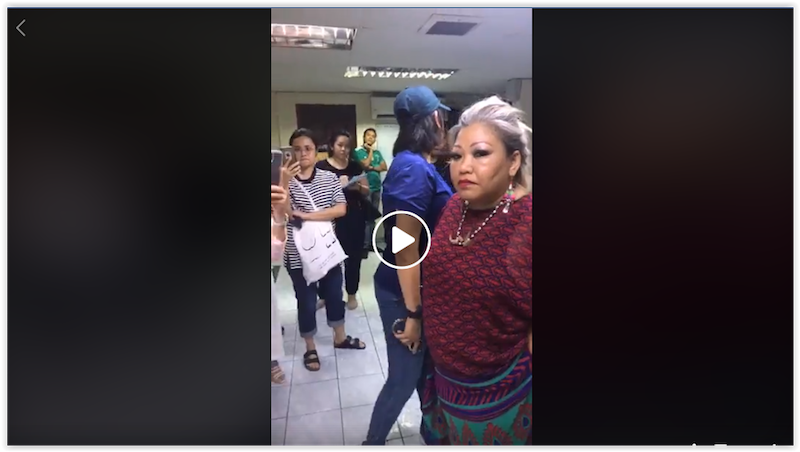 A screengrab from a Facebook video showing a policewoman who wanted to handcuff Siti Kasim at the Kajang district police headquarters on June 24, 2018.