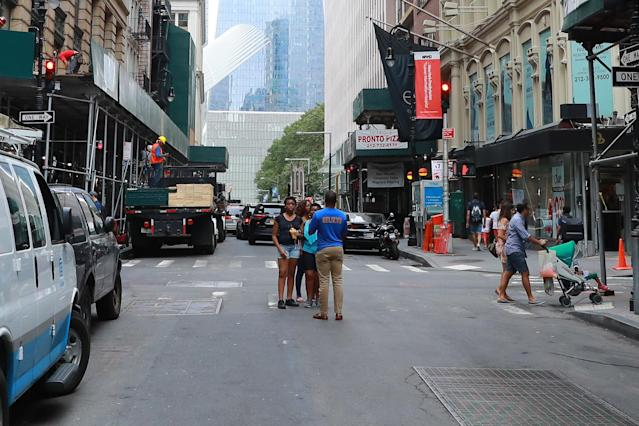<p>Construction on Fulton Street at Nassau Street continues as people take photos with One World Trade Center in the background, Aug. 12, 2017. (Photo: Gordon Donovan/Yahoo News) </p>