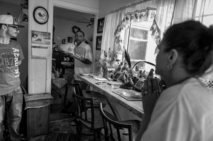 <p>Gene Robinson, middle, talks to his step-son Larry Fugate, left, and far right, mom Terri Fugate at their home in Middletown, Ohio. Both men are recovering heroin addicts.<br> (Photograph by Mary F. Calvert for Yahoo News) </p>