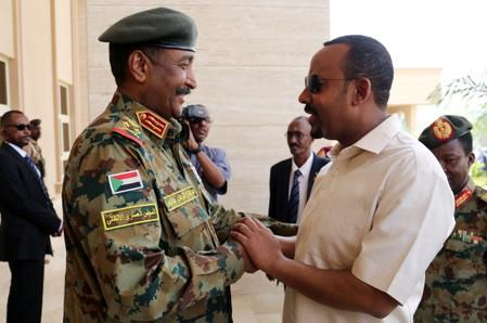 Ethiopian Prime Minister Abiy Ahmed meets Sudan's Head Of Transitional Military Council, Lieutenant General Abdel Fattah Al-Burhan Abdelrahman to mediate in the political crisis at the airport in Khartoum