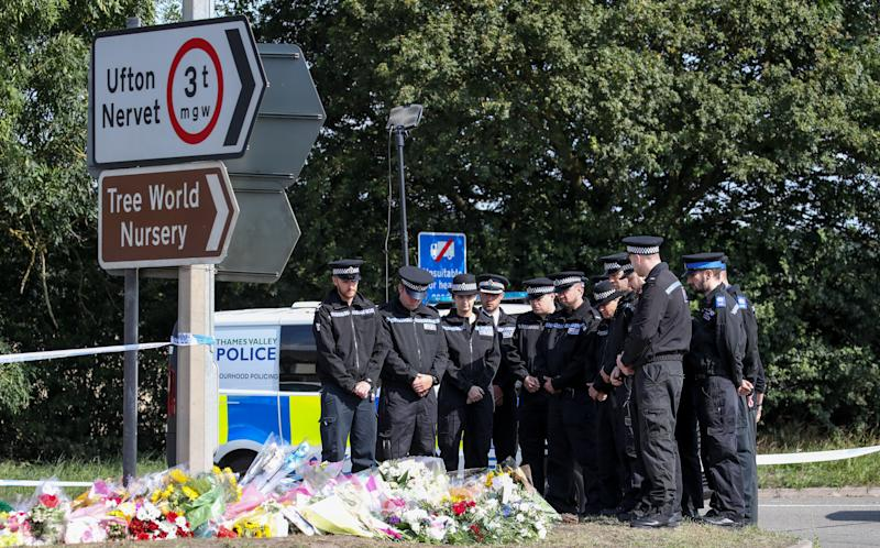 File photo dated 20/08/19 of police officers gathering to pay their respects at the scene in Sulhamstead, Berkshire, where Thames Valley Police officer Pc Andrew Harper died. Driver Henry Long, 19, has been found not guilty at the Old Bailey of murder, but had ealier pleaded guilty to manslaughter. His passengers Jessie Cole and Albert Bowers, both 18, were cleared of murder but found guilty of manslaughter for the death of Pc Andrew Harper, who had been attempting to apprehend quad bike thieves when he was killed on the night of August 15, 2019.