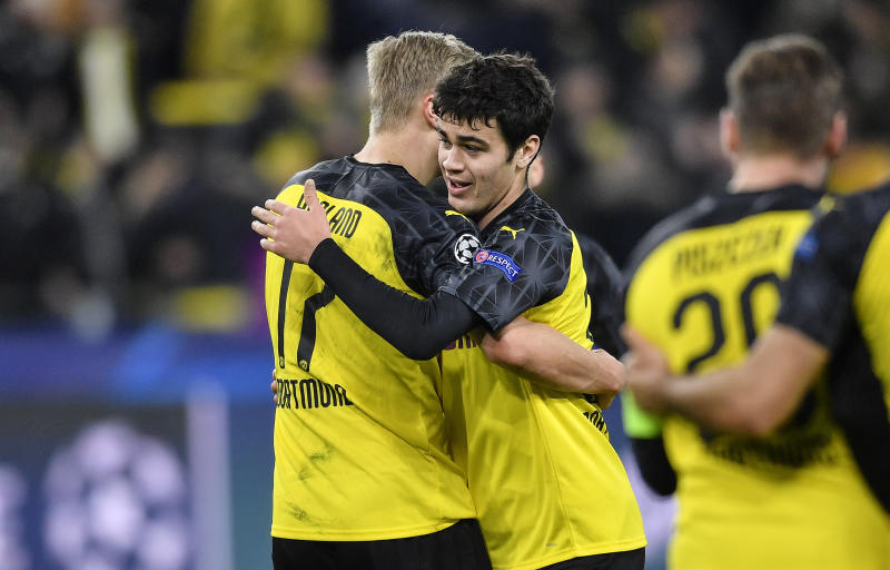 Dortmund's Giovanni Reyna, right, embraces Dortmund's Erling Braut Haaland after the Champions League round of 16 first leg soccer match between Borussia Dortmund and Paris Saint Germain in Dortmund, Germany, Tuesday, Feb. 18, 2020. Reyna is the youngest American ever playing in Champions League. (AP Photo/Martin Meissner)