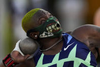 Raven Saunders competes during the finals of the women's shot put at the U.S. Olympic Track and Field Trials Thursday, June 24, 2021, in Eugene, Ore. (AP Photo/Charlie Riedel)