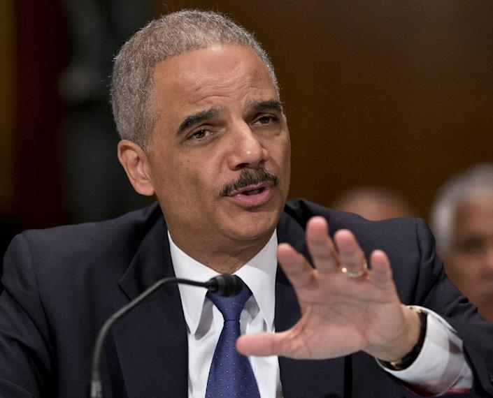 FILE - In this June 6, 2013, file photo, Attorney General Eric Holder testifies on Capitol Hill in Washington, Thursday, June 6, 2013. The U.S. government's aggressive prosecution of leaks and efforts to control information are having a chilling effect on journalists and government whistle-blowers, according to a report released Thursday, Oct. 10, 2013, on U.S. press freedoms under the Obama administration. (AP Photo/J. Scott Applewhite, File)