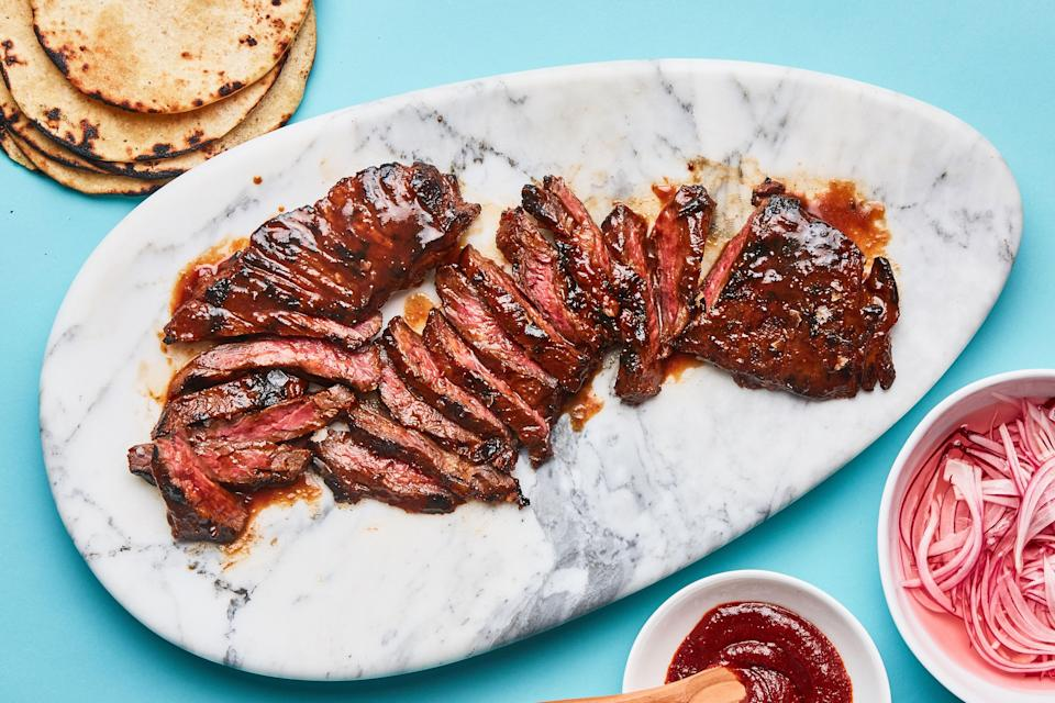"Skirt steak is the ultimate summer steak for grilling—quick cooking, buttery, and versatile. <a href=""https://www.bonappetit.com/recipe/gochujang-marinated-skirt-steak?mbid=synd_yahoo_rss"" rel=""nofollow noopener"" target=""_blank"" data-ylk=""slk:See recipe."" class=""link rapid-noclick-resp"">See recipe.</a>"
