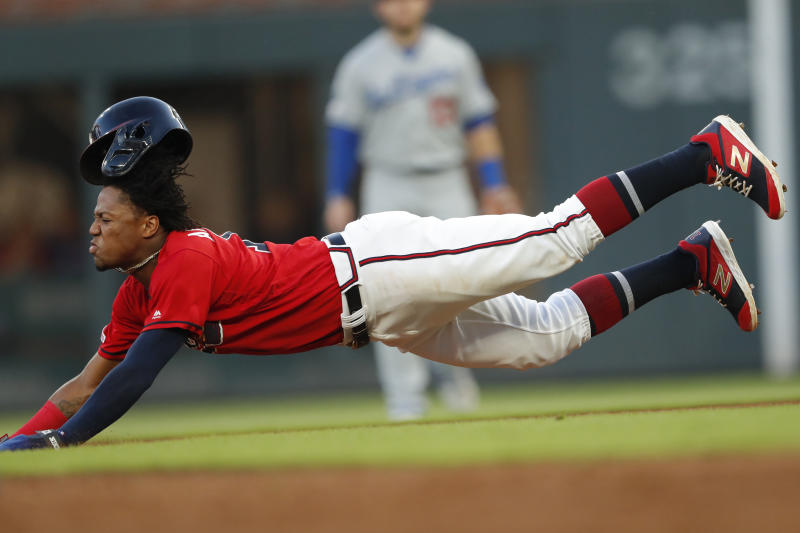 Atlanta Braves' Ronald Acuna Jr. steals second base in the second inning of a baseball game against the Los Angeles Dodgers, Friday, Aug. 16, 2019, in Atlanta. (AP Photo/John Bazemore)