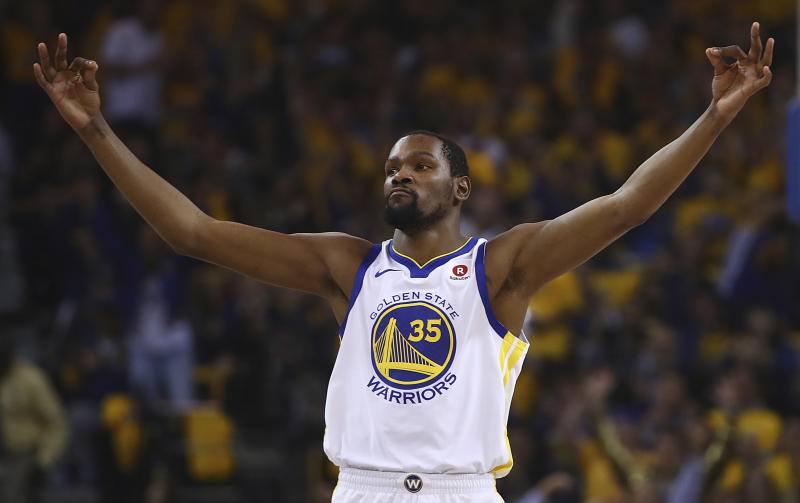 Golden State Warriors' Kevin Durant celebrates a score against the San Antonio Spurs during the first quarter in Game 5 of a first-round NBA basketball playoff series Tuesday, April 24, 2018, in Oakland, Calif. (AP Photo/Ben Margot)