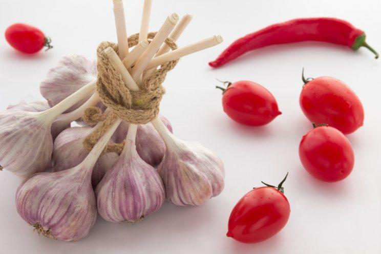 Neither garlic or tomatoes should be kept in the fridge [Photo: Getty]