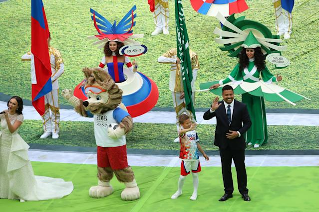<p>Zabivaka the FIFA World Cup Russia mascot and Brazil legend Ronaldo wave to the crowd during the opening ceremony. (Getty) </p>