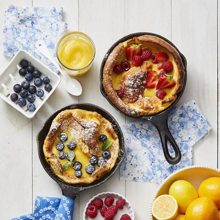 "<p>The perfect Mother's Day brunch dessert, top these fluffy pancakes with fresh fruit for a sweet finish.</p><p><em><a href=""https://www.womansday.com/food-recipes/a32291688/dutch-babies-recipe/"" rel=""nofollow noopener"" target=""_blank"" data-ylk=""slk:Get the recipe for Dutch Babies."" class=""link rapid-noclick-resp"">Get the recipe for Dutch Babies.</a></em></p>"