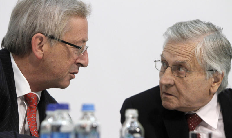 Eurogroup president Jean-Claude Juncker, left, and  European Central Bank governor Jean-Claude Trichet speak at a press conference  during  an informal meeting of the Economic and Financial Affairs Council (ECOFIN) in  in Wroclaw ,  Poland on Friday, Sept. 16, 2011. Rescue partners will decide in October on a   crucial payout of bailout loan money to bankruptcy-threatened Greece. Juncker and other eurozone finance ministers were discussing Europe's financial crisis at an informal meeting in Wroclaw.(AP Photo/Czarek Sokolowski)