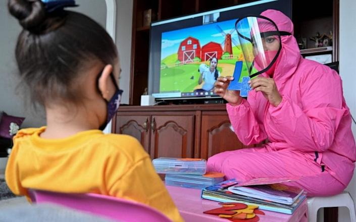 The 'teacher at home' scheme has been implemented by a local school. CREDIT: GETTY - LUIS ROBAYO /Getty