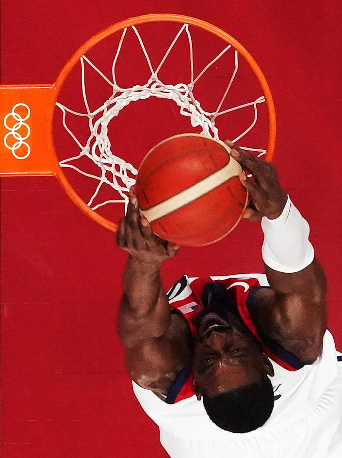 <p>Khris Middleton of Team USA dunks against Iran during a men's preliminary round Group A basketball game on day five of the Tokyo 2020 Olympic Games.</p>